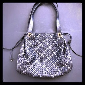 Large leather woven shoulder bag & leather lined.